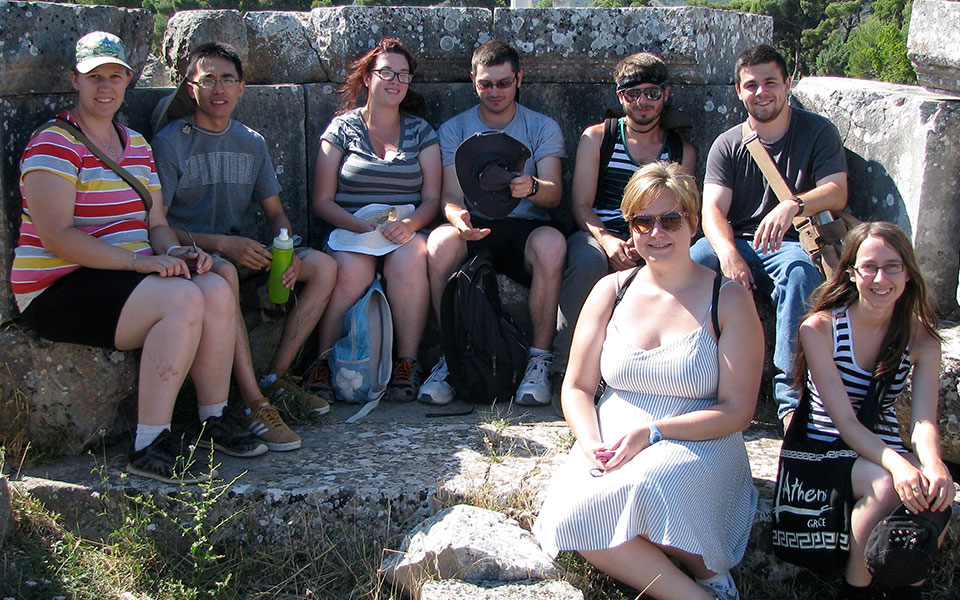 Group sitting on ancient ruins