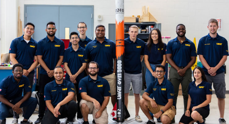 Engineering group with a rocket